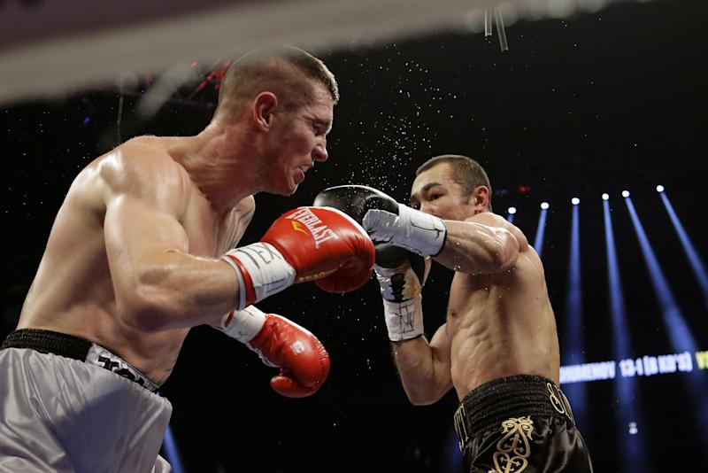 Beibut Shumenov, right, hits Tamas Kovacs, left, during their WBA Super World and IBA light heavyweight title fight, Saturday, Dec. 14, 2013, in San Antonio. (AP Photo/Eric Gay)
