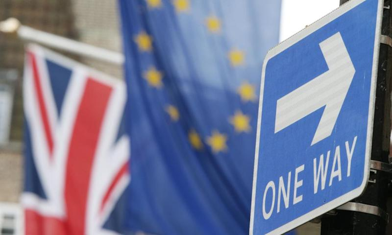 UK and Europe flag, with One Way sign in the foreground