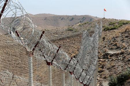 A view of the border fence outside the Kitton outpost on the border with Afghanistan in North Waziristan, Pakistan October 18, 2017.  REUTERS/Caren Firouz