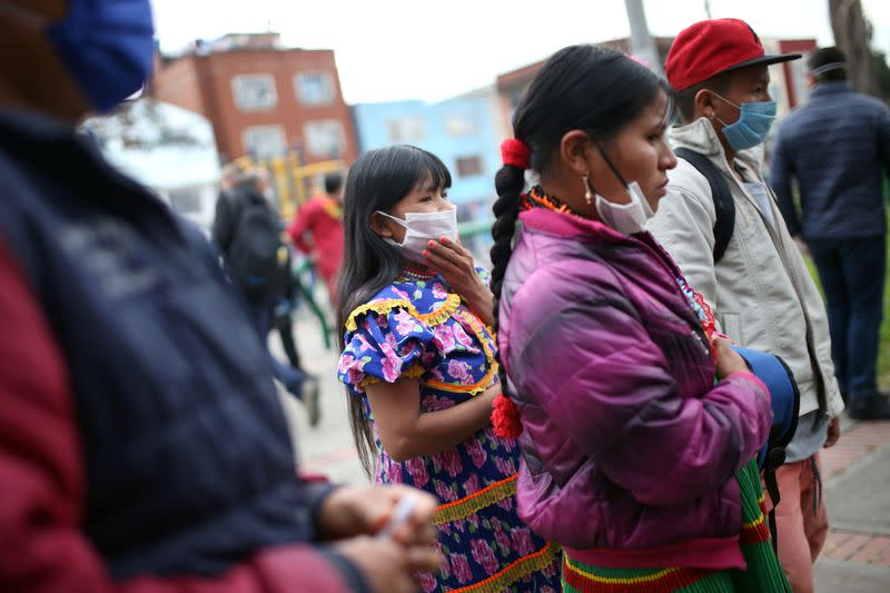 An indigenous woman wearing a protective face mask as a preventive measure against the spread of the coronavirus disease (COVID-19) is seen after being evicted from a building in Bogota