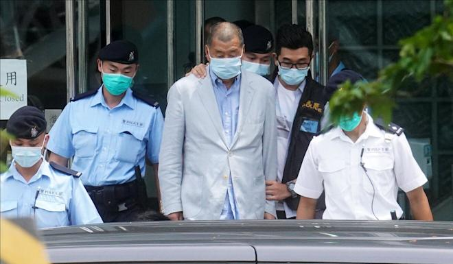 Police lead Hong Kong media mogul Jimmy Lai away from the Next Digital Limited building in Tseung Kwan O, where his tabloid newspaper Apple Daily is headquartered. Photo: Winson Wong