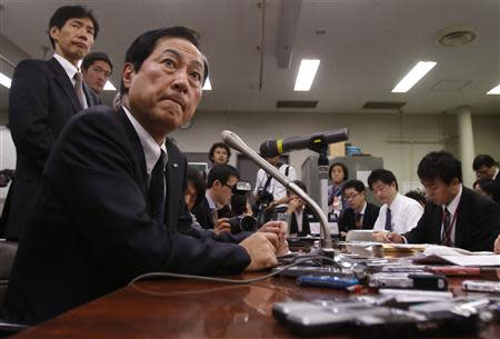 Mizuho Financial Group President Sato attends a news conference at the Bank of Japan headquarters in Tokyo