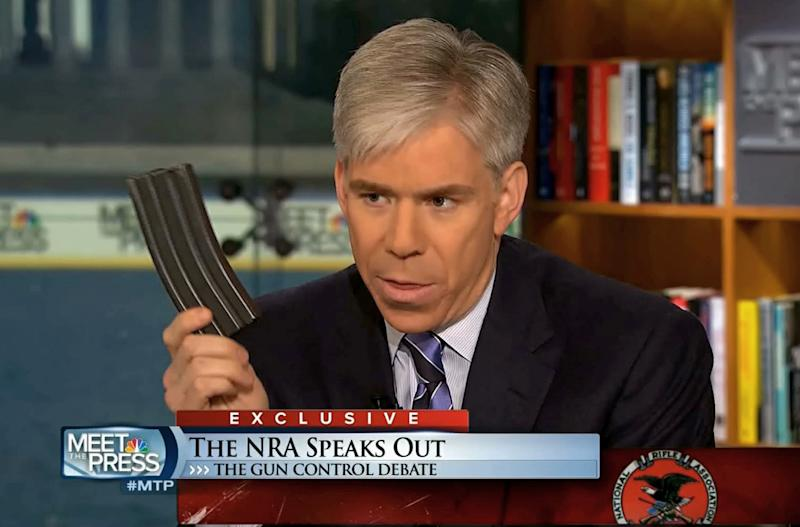 "This video frame grab image provided by""Meet the Press"" shows host David Gregory holding what he described as a high-capacity ammunition magazine during a recent Sunday's program. Gregory won't face charges for displaying what he said was a high-capacity ammunition magazine on his ""Meet the Press"" show. D.C. prosecutors announced the decision Friday, saying criminal charges wouldn't serve the public's best interests. (AP Photo/Meet the Press)"