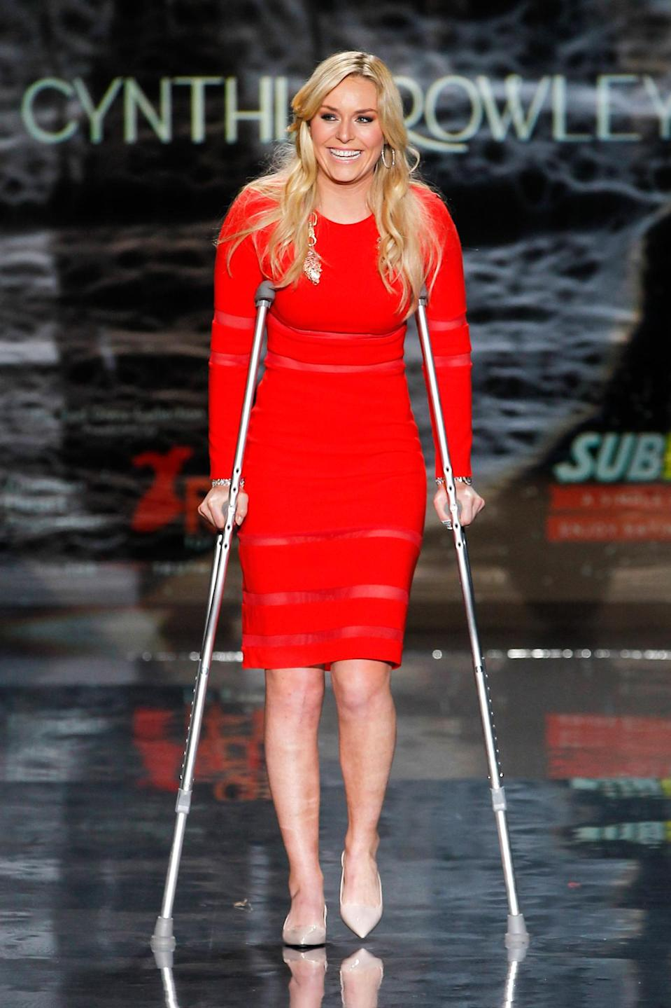 <p>Lindsey Vonn had her runway moment at the Red Dress fashion show in 2014, taking her turn on the catwalk on crutches, like the boss she is. <i>(Photo: Getty)</i></p>