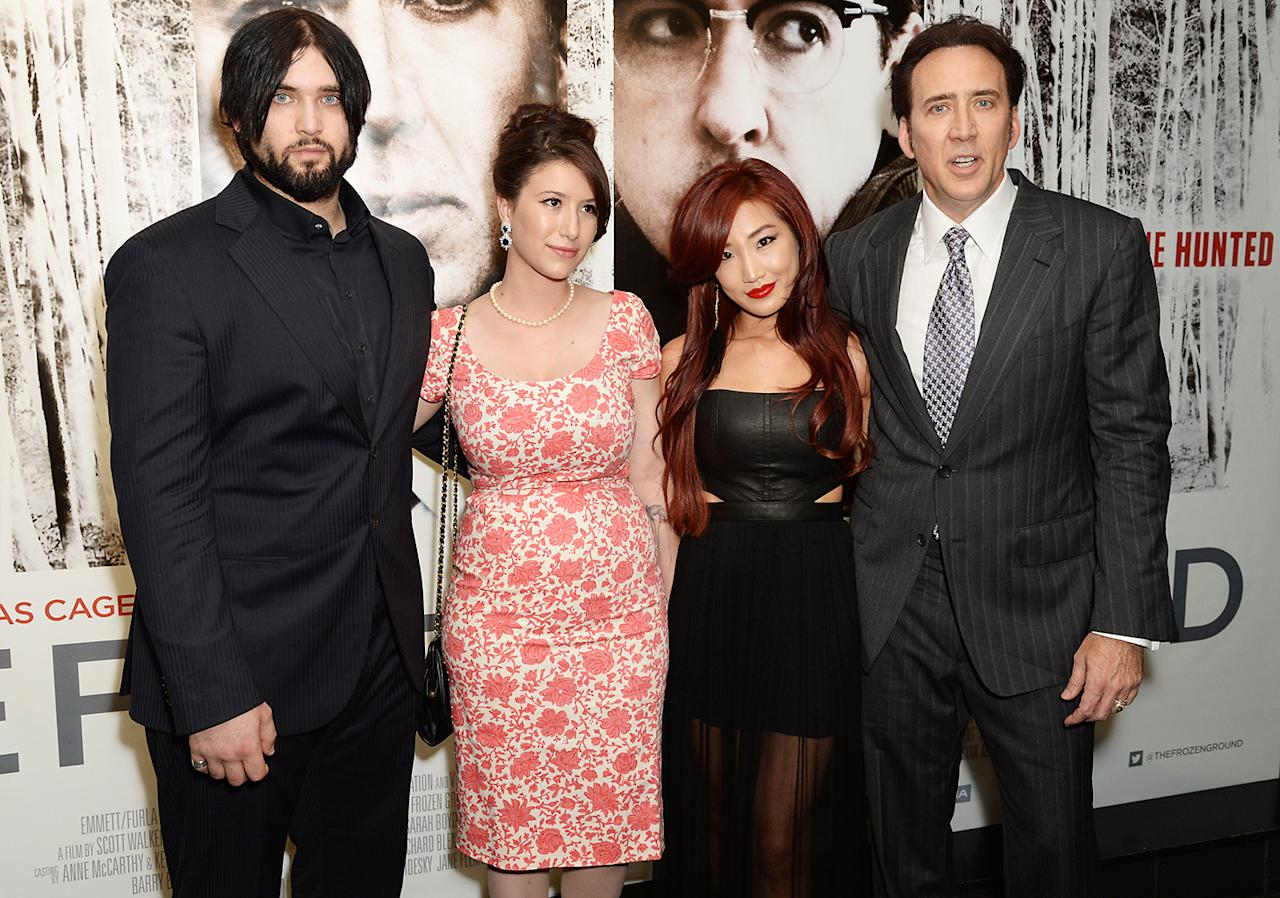 LONDON, ENGLAND - JULY 17:  (L-R) Weston Cage, Danielle Cage, Alice Kim and Nicolas Cage attend the UK premiere of 'The Frozen Ground' at The Vue Leicester Square on July 17, 2013 in London, England.  (Photo by Dave J Hogan/Getty Images)