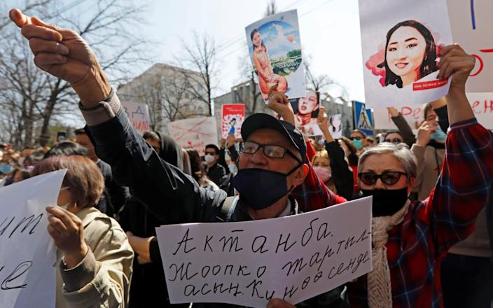 People attend a rally in front of Kyrgyzstan's interior ministry - VLADIMIR PIROGOV/REUTERS