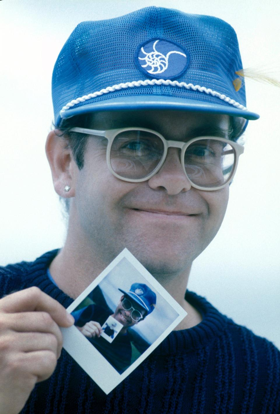 """Elton John smiles during his stay at Air Studios Montserrat in 1982, where he recorded his biggest album of the '80s, """"Too Low for Zero."""""""