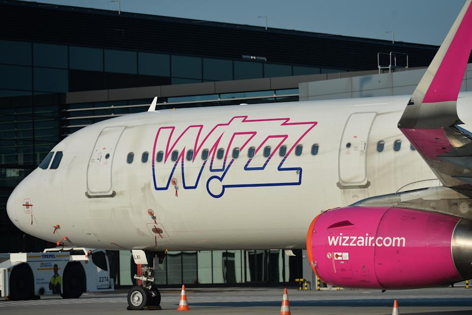 A view of Wizzair grounded plane at the John Paul II Krakow-Balice International Airport. Wizz Air, the CEE regions largest budget airline, celebrated the 16th anniversary of its founding via offering a 16% discount on bookings.  On Monday, May 18, 2020, in John Paul II Krakow-Balice International Airport, Krakow, Poland. (Photo by Artur Widak/NurPhoto via Getty Images)