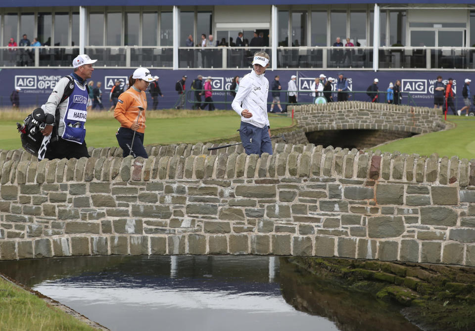 United States' Nelly Korda, right talks to Japan's Nasa Hataoka as they cross the stone bridge to the 18th green during the first round of the Women's British Open golf championship, in Carnoustie, Scotland, Thursday, Aug. 19, 2021. (AP Photo/Scott Heppell)