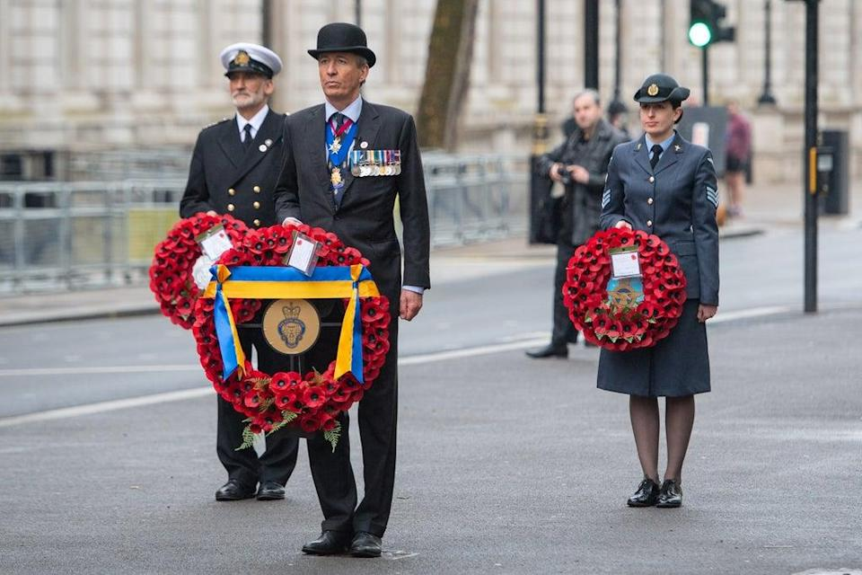 National president of the Royal British Legion Lieutenant General (Retired) James Bashall, centre, and members from the Royal Navy, the British Army, the Royal Air Force and the Merchant Navy at the Cenotaph in London (Dominic Lipinski/PA) (PA Wire)