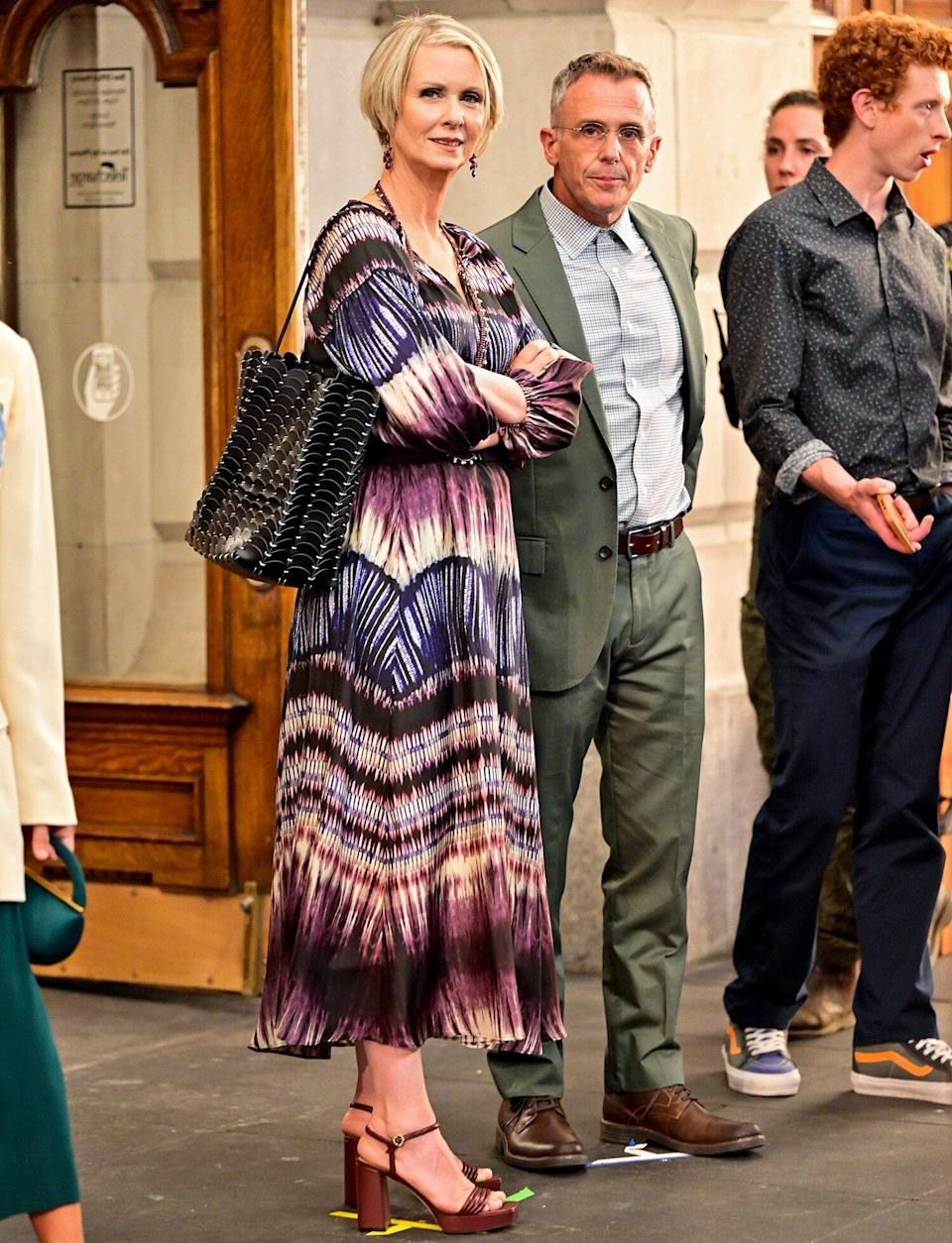 """Cynthia Nixon and David Eigenberg seen on the set of """"And Just Like That..."""" the follow up series to """"Sex and the City"""" at the Lyceum Theater on July 24, 2021 in New York City."""