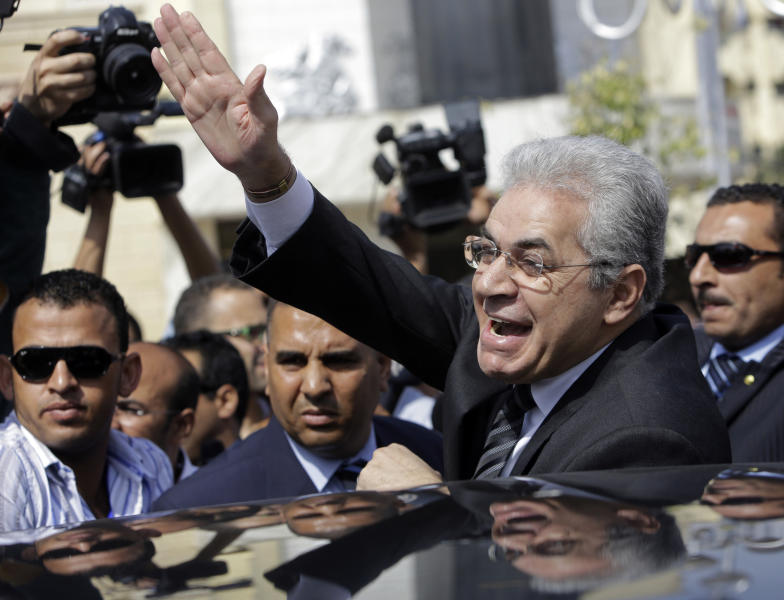 Presidential hopeful leftist politician Hamdeen Sabahi, who finished a strong third in the first round of the last presidential election, in June 2012, greets his supporters outside the election commission office in Cairo, Egypt, Saturday, April 19, 2014. Sabahi submitted required signatures to the election commission as the final formal step to run in next month's presidential election. The presidential ballot will be followed by a parliamentary election later this year. (AP Photo/Amr Nabil)