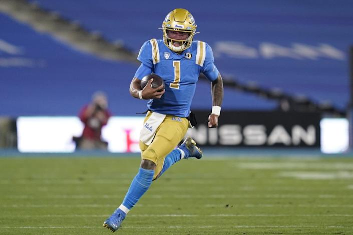 UCLA quarterback Dorian Thompson-Robinson runs the ball during the second quarter against USC on Dec. 12, 2020.