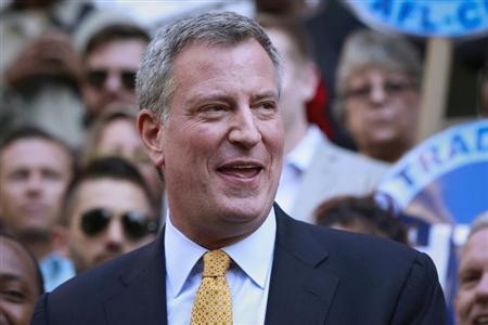 New York City Democratic mayoral nominee de Blasio speaks after receiving endorsement of former mayoral candidate and City Council Speaker Quinn during press conference at City Hall in New York