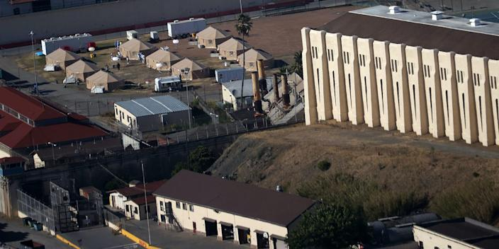 """A view of a new emergency care facility that was erected to treat inmates infected with COVID-19 at San Quentin State Prison on July 08, 2020 in San Quentin, California. <p class=""""copyright"""">Justin Sullivan/Getty Images</p>"""