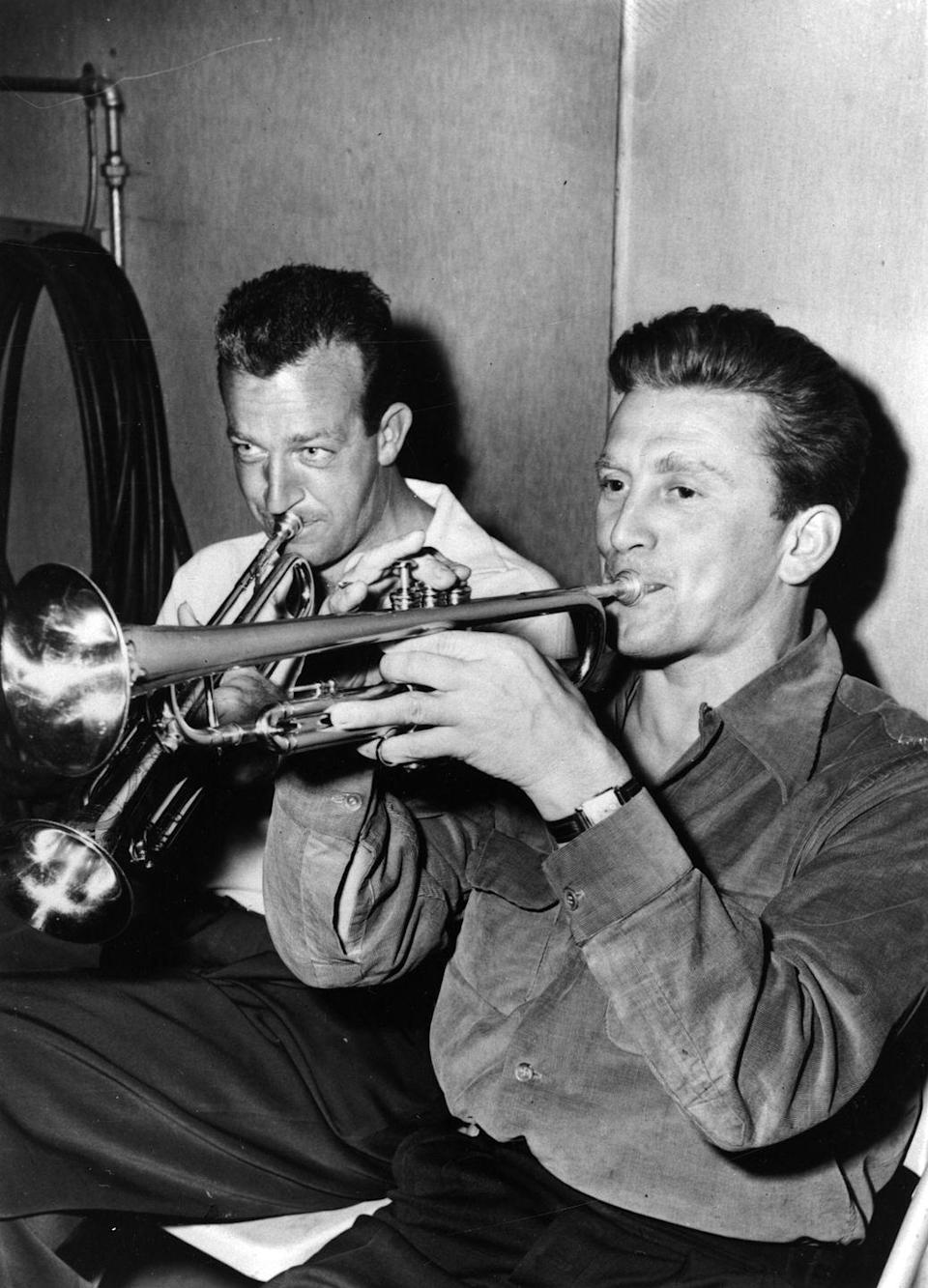 <p>Douglas plays the trumpet with bandleader and trumpeter Harry James.</p>