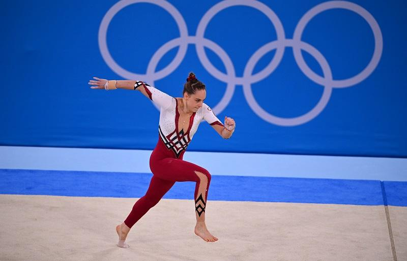 Sarah Voss of Germany sports a full-length unitard during the floor exercise. Image credit: Reuters/Dylan Martinez