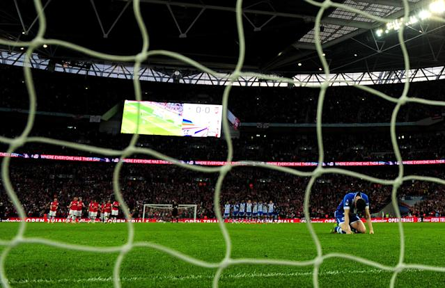 LONDON, ENGLAND - APRIL 12: Gary Caldwell of Wigan Athletic reacts after missing a penalty in the shoot out during the FA Cup Semi-Final match between Wigan Athletic and Arsenal at Wembley Stadium on April 12, 2014 in London, England. (Photo by Shaun Botterill/Getty Images)