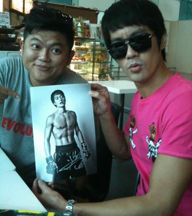"""Legend of Bruce Lee"" star Danny Chan poses with a photo Kho shot for MMA film ""The Spirit of Fight"". (Photo by Let There Be Light)"