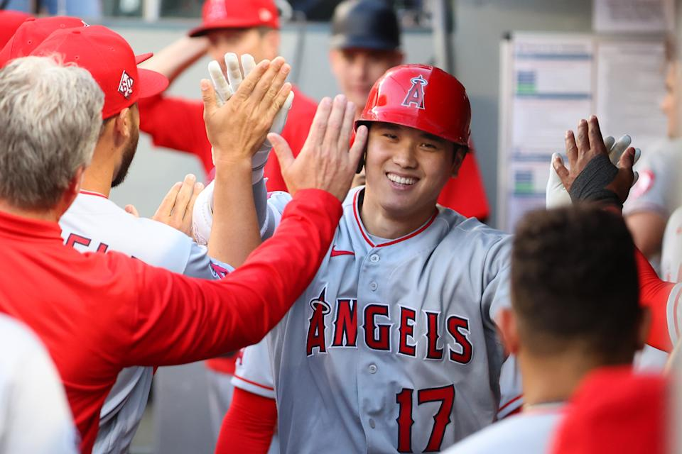 SEATTLE, WASHINGTON - JULY 09: Shohei Ohtani #17 of the Los Angeles Angels celebrates in the dugout after hitting a solo home run during the third inning against the Seattle Mariners at T-Mobile Park on July 09, 2021 in Seattle, Washington. (Photo by Abbie Parr/Getty Images)