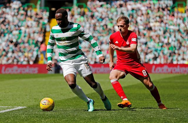 Soccer Football - Scottish Premiership - Celtic vs Aberdeen - Celtic Park, Glasgow, Britain - May 13, 2018 Celtic's Moussa Dembele in action with Aberdeen's Greg Stewart REUTERS/Russell Cheyne