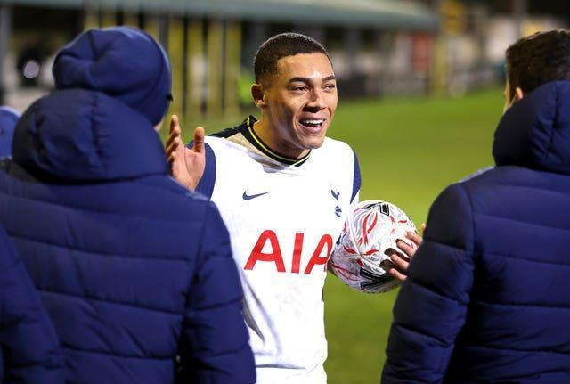 Tottenham striker Carlos Vinicius celebrates with the match ball after scoring a hat-trick at Marine