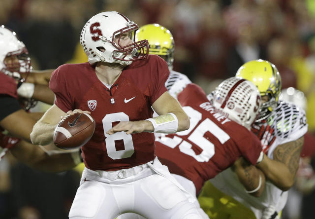 Stanford quarterback Kevin Hogan (8) passes against Oregon during the first quarter of an NCAA college football game in Stanford, Calif., Thursday, Nov. 7, 2013. (AP Photo/Jeff Chiu)