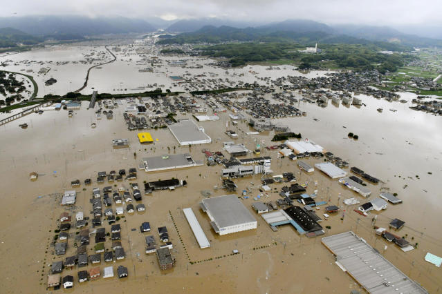 <p>Buildings are almost submerged in floodwaters caused by heavy rains in Kurashiki, Okayama prefecture, southwestern Japan, Saturday, July 7, 2018. (Photo: Shingo Nishizume/Kyodo News via AP) </p>