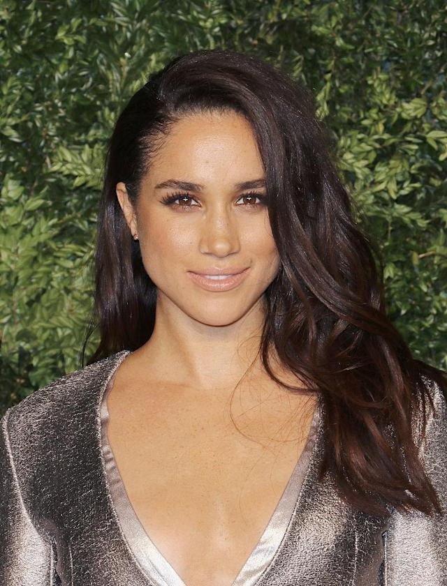 <p>For the 12th annual Vogue Fashion Fund Awards on Nov. 2, Meghan rocked a side part and debuted a longer length. (Photo: Getty Images) </p>