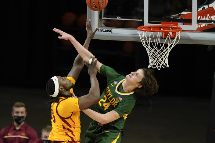 Iowa State forward Solomon Young shoots over Baylor guard Matthew Mayer (24) during the second half of an NCAA college basketball game, Saturday, Jan. 2, 2021, in Ames, Iowa. Baylor won 76-65. (AP Photo/Charlie Neibergall)
