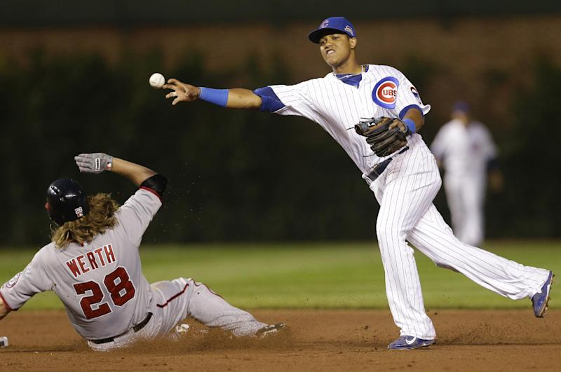 Chicago Cubs shortstop Starlin Castro, right, throws out Washington Nationals' Adam LaRoche at first base after forcing out Jayson Werth during the sixth inning of a baseball game in Chicago, Thursday, June 26, 2014. (AP Photo/Nam Y. Huh)