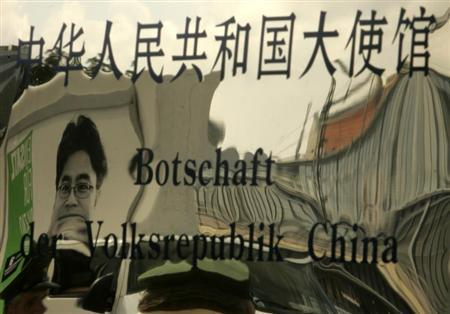 A picture of jailed Chinese journalist Shi Tao is reflected in the entrance sign of China's embassy in Berlin