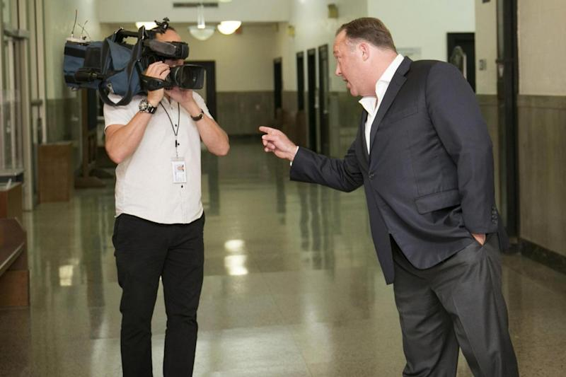 Alex Jones 'looks like Tony Soprano and loses his temper like a kettle coming to the boil' (AP)