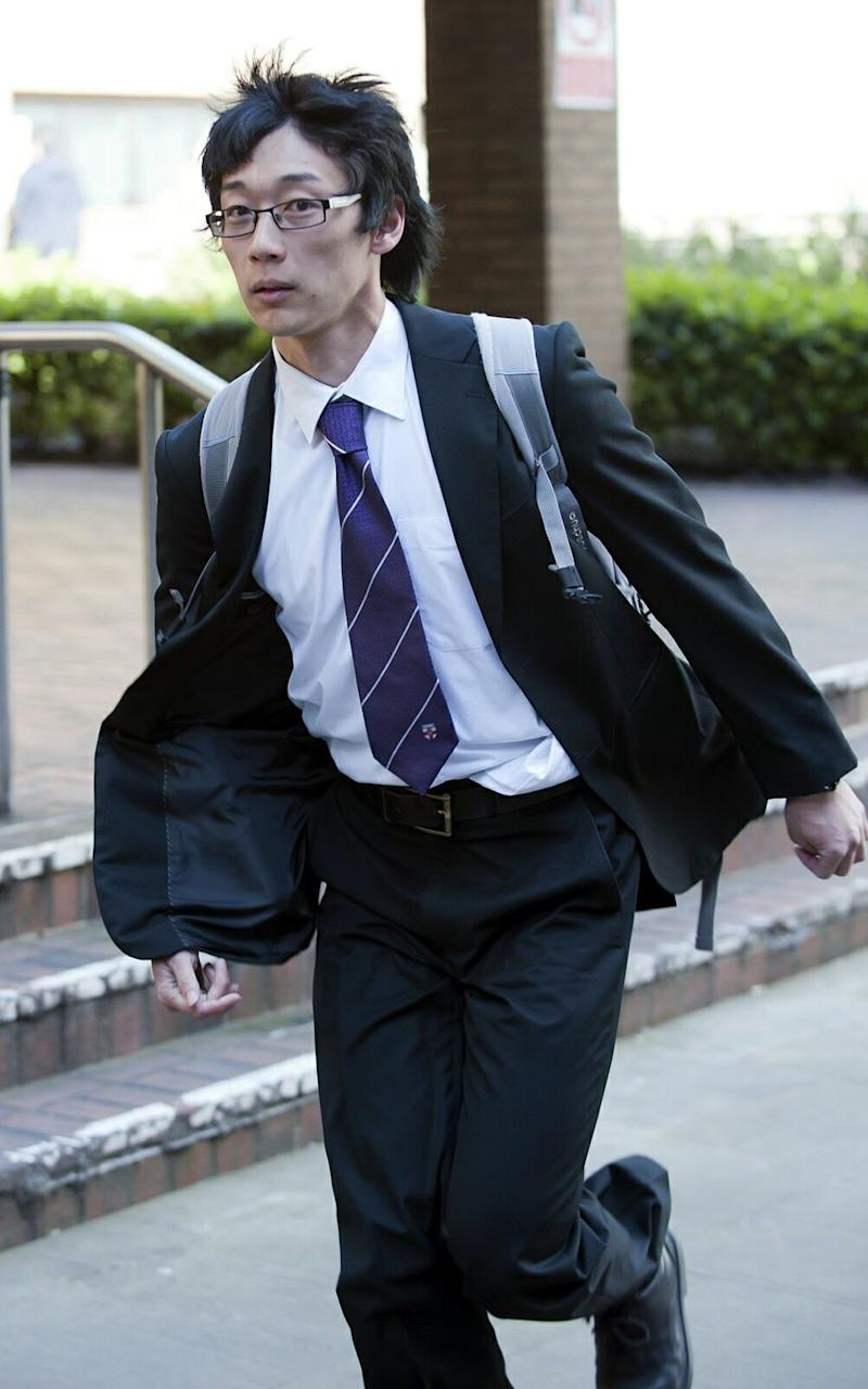 Statistician Sherman Ip was pictured leaving court on Wednesday  - Credit: central news