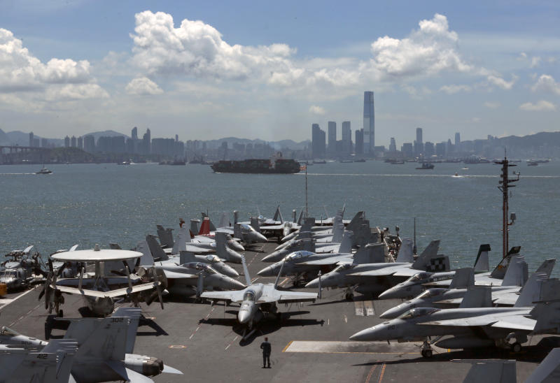 FILE - In this July 10, 2012 file photo, the USS George Washington aircraft carrier makes a port call in Hong Kong. As President Barack Obama tours Southeast Asia to push his year-old pivot to the Pacific policy, the big question on everybody's mind is how much of a role Washington, with its mighty military and immense diplomatic clout, can play in keeping the Pacific peaceful. (AP Photo/Kin Cheung, File)