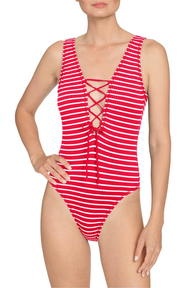 "<p><a href=""https://www.popsugar.com/buy/Robin-Piccone-Sailor-Lace-Up-Plunge-One-Piece-Swimsuit-579949?p_name=Robin%20Piccone%20Sailor%20Lace-Up%20Plunge%20One-Piece%20Swimsuit&retailer=shop.nordstrom.com&pid=579949&price=60&evar1=fab%3Aus&evar9=47531607&evar98=https%3A%2F%2Fwww.popsugar.com%2Ffashion%2Fphoto-gallery%2F47531607%2Fimage%2F47532277%2FRobin-Piccone-Sailor-Lace-Up-Plunge-One-Piece-Swimsuit&list1=shopping%2Cnordstrom%2Csummer%20fashion%2Csale%20shopping&prop13=mobile&pdata=1"" rel=""nofollow"" data-shoppable-link=""1"" target=""_blank"" class=""ga-track"" data-ga-category=""Related"" data-ga-label=""https://shop.nordstrom.com/s/robin-piccone-sailor-lace-up-plunge-one-piece-swimsuit/5635697?origin=category-personalizedsort&amp;breadcrumb=Home%2FSale%2FWomen%2FNew%20Markdowns&amp;color=fiery%20red%2Fwhite"" data-ga-action=""In-Line Links"">Robin Piccone Sailor Lace-Up Plunge One-Piece Swimsuit</a> ($60, originally $148)</p>"