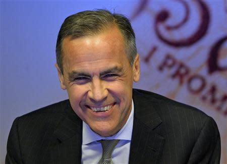 Bank of England Governor Mark Carney smiles during the bank's quarterly inflation report news conference at the Bank of England in London