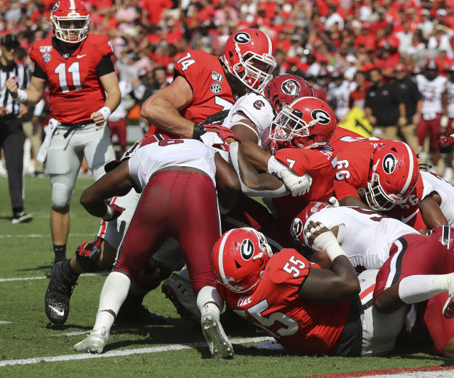 Georgia tailback (7) D'Andre Swift powers his way into the endzone for a one-yard touchdown run against South Carolina during the second quarter of an NCAA college football game, Saturday, Oct., 12, 2019, in Athens, Ga. (Curtis Compton/Atlanta Journal-Constitution via AP)