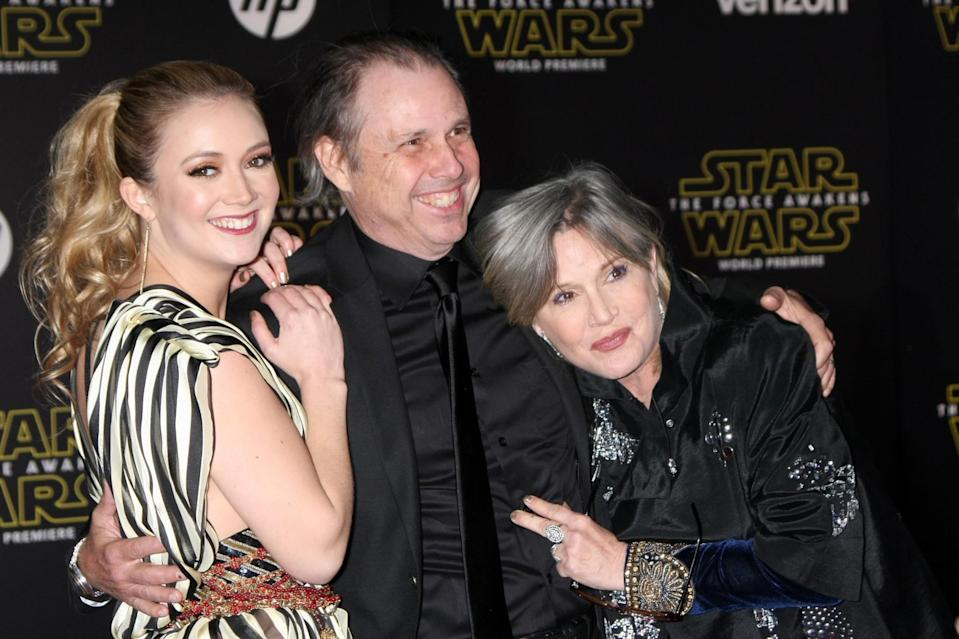 L-R: Billie Lourd, Todd Fisher and Carrie Fisher at the world premiere of 'The Force Awakens' (credit: WENN)