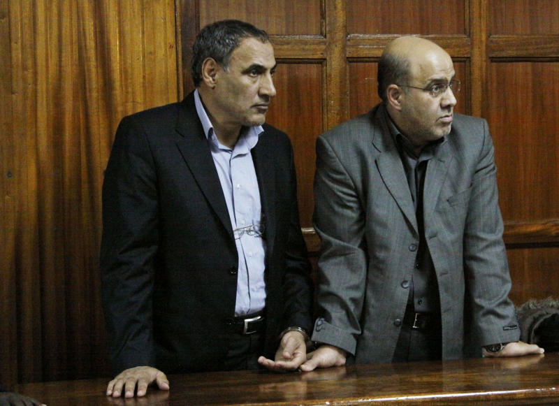 Iranian nationals Sayed Mansour Mousavi, left, and Ahmed Abolfathi Mohammed, right stand in the Nairobi magistrates court in Nairobi, Kenya, Wednesday, June 27, 2012. One of two Iranians facing charges related to accusations the two planned to carry out an attack with explosives in Kenya says he was interrogated by Israeli agents while in detention. Ahmad Abolfathi Mohammad also told a Kenyan court on Wednesday the Israeli agent tortured and injected him with chemicals without his consent  (AP Photo/Khalil Senosi)