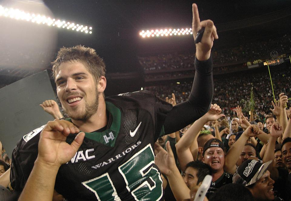 ** FILE ** Hawaii quarterback Colt Brennan (15) celebrates after defeating Boise State 39-27 in their college football game in Honolulu, in this Nov. 23, 2007 file photo. The four Heisman finalists were announced Wednesday, Dec. 5, 2007. They are Hawaii quarterback Colt Brennan, Missouri quarterback Chase Daniel, Arkansas running back Darren McFadden and Florida quarterback Tim Tebow. (AP Photo/Ronen Zilberman)