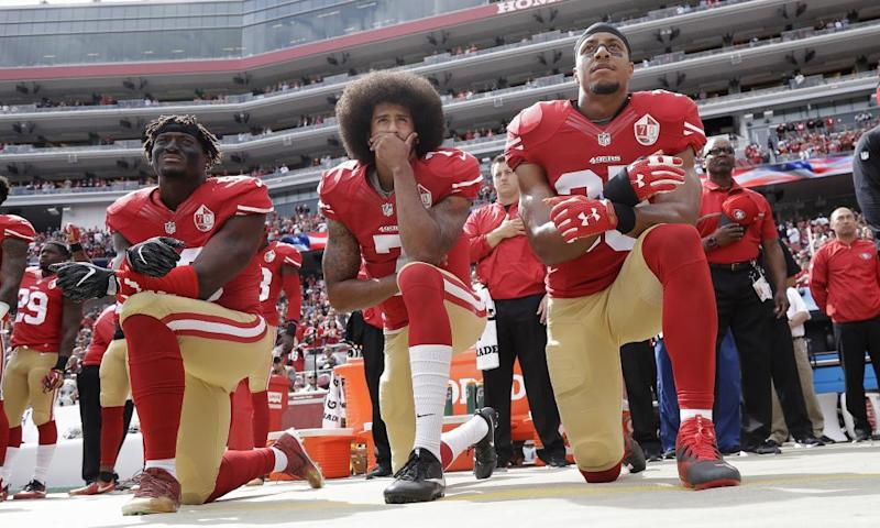 Colin Kaepernick kneels for the anthem before a game against the Cowboys in October.