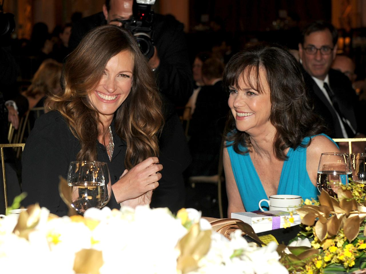 CULVER CITY, CA - JUNE 07:  Actresses Julia Roberts (L) and Sally Field attend the 40th AFI Life Achievement Award honoring Shirley MacLaine held at Sony Pictures Studios on June 7, 2012 in Culver City, California. The AFI Life Achievement Award tribute to Shirley MacLaine will premiere on TV Land on Saturday, June 24 at 9PM ET/PST.  (Photo by Kevin Winter/Getty Images for AFI)