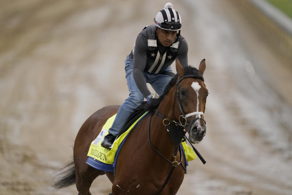 Kentucky Derby entrant Mandaloun works out at Churchill Downs Thursday, April 29, 2021, in Louisville, Ky. The 147th running of the Kentucky Derby is scheduled for Saturday, May 1. (AP Photo/Charlie Riedel)
