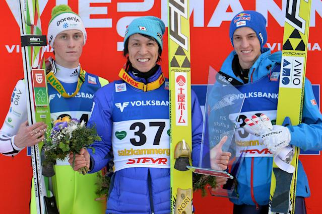 Japan's winner Noriaki Kasai, center, Slovenia's second placed Peter Prevc, left, and Austria's third placed Gregor Schlierenzauer pose for the media after the World Cup event in Bad Mitterndorf, Austria, on Saturday, Jan. 11. 2014. Japanese ski jumper Noriaki Kasai became the oldest winner of a World Cup competition at age 41 after upsetting the favorites in a ski flying event on Saturday. Kasai had jumps of 196.0 and 197.0 meters and gathered 391.6 points for his 16th career victory but first in almost 10 years. His previous win came in Park City, Utah, on Feb. 28, 2004. (AP Photo/Kerstin Joensson)