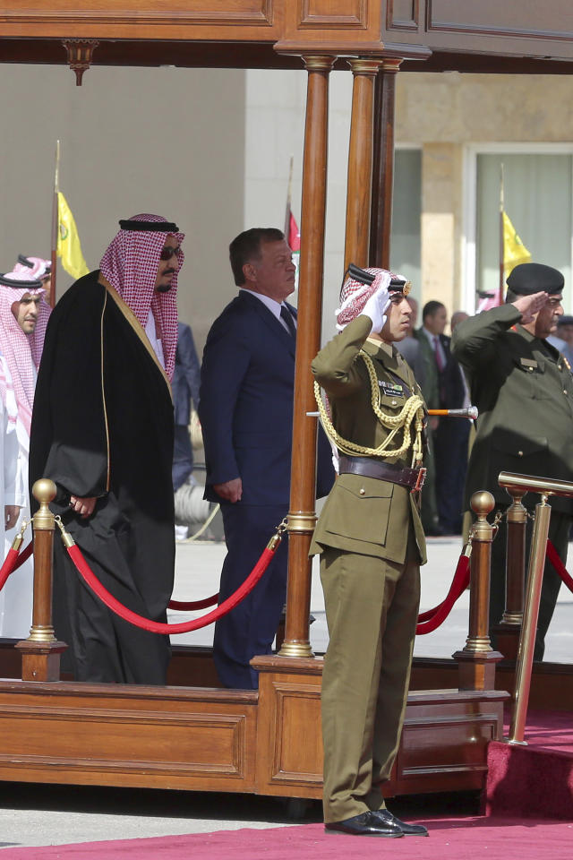 Saudi Arabia's King Salman, left, reviews an honor guard with Jordan's King Abdullah II in a lavish welcome ceremony complete with cannon salutes and guards on camel back, Amman Jordan, Monday, March 27, 2017. Salman is in Jordan to attend the annual Arab Summit, to be held on Wednesday. Issues on the summit agenda include conflicts in Syria, Libya and Yemen. Saudi Arabia is an important financial backer of Jordan. (AP Photo/ Raad Adayleh)