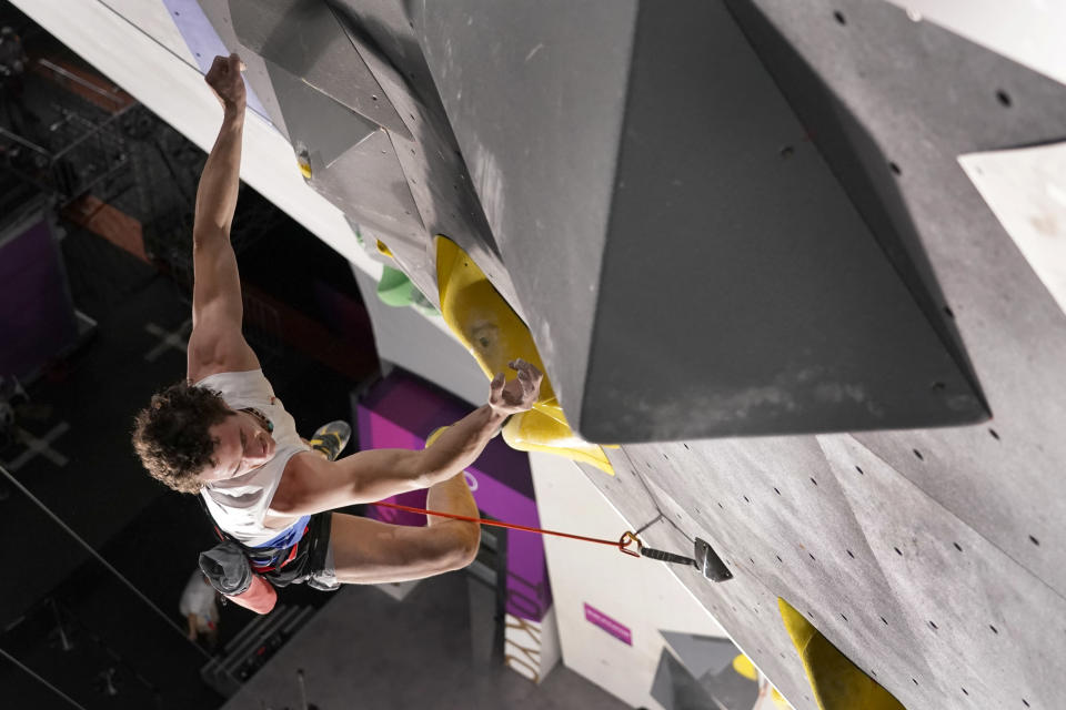 Adam Ondra, of the Czech Republic, looses his grip and falls as he nears the top during the lead qualification portion of the men's sport climbing competition at the 2020 Summer Olympics, Tuesday, Aug. 3, 2021, in Tokyo, Japan. (AP Photo/Jeff Roberson, POOL)
