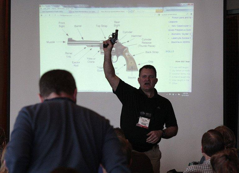 A firearms instructor teaches a concealed-weapons training class to 200 Utah teachers on December 27, 2012 in West Valley City, Utah. Several US states are considering allowing school teachers to carry weapons, and educators, determined not to allow a repeat of the Newtown massacre, are flocking to training sessions