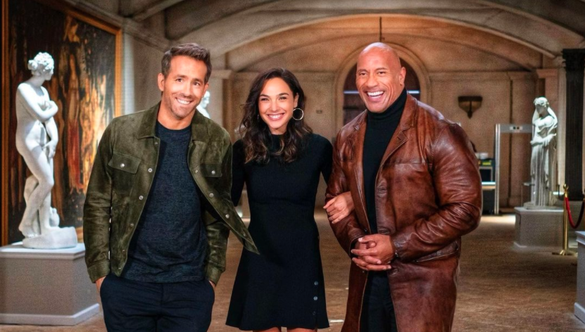 The Rock shared this photo of himself with co-stars Ryan Reynolds and Gal Gadot to celebrate wrapping on Red Notice. (Instagram/TheRock)