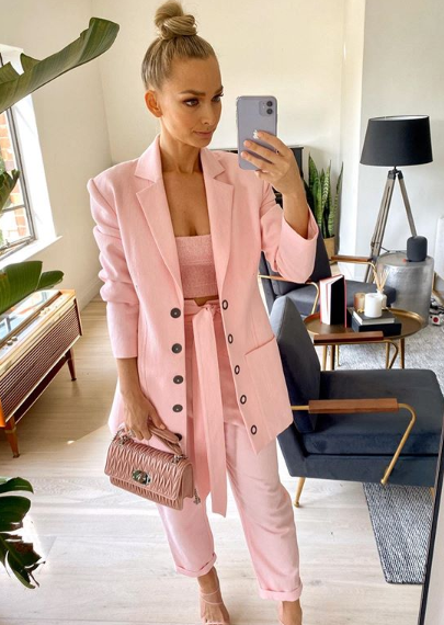 A photo of Anna Heinrich wearing a pink suit.